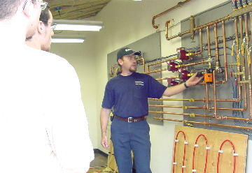 Hannabery technician teaching students on the radiant trainer